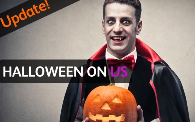 man dressed as Dracula with halloween pumpkin in hand